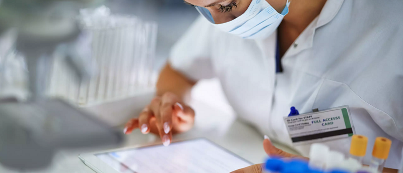 Woman in the medical field looking at her tablet