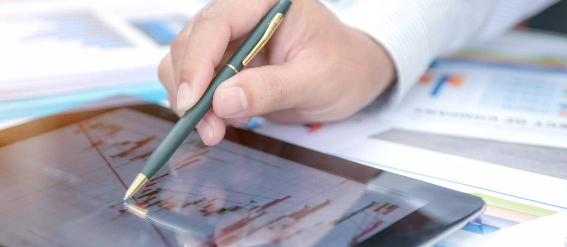 Person pointing at a tablet using a pen